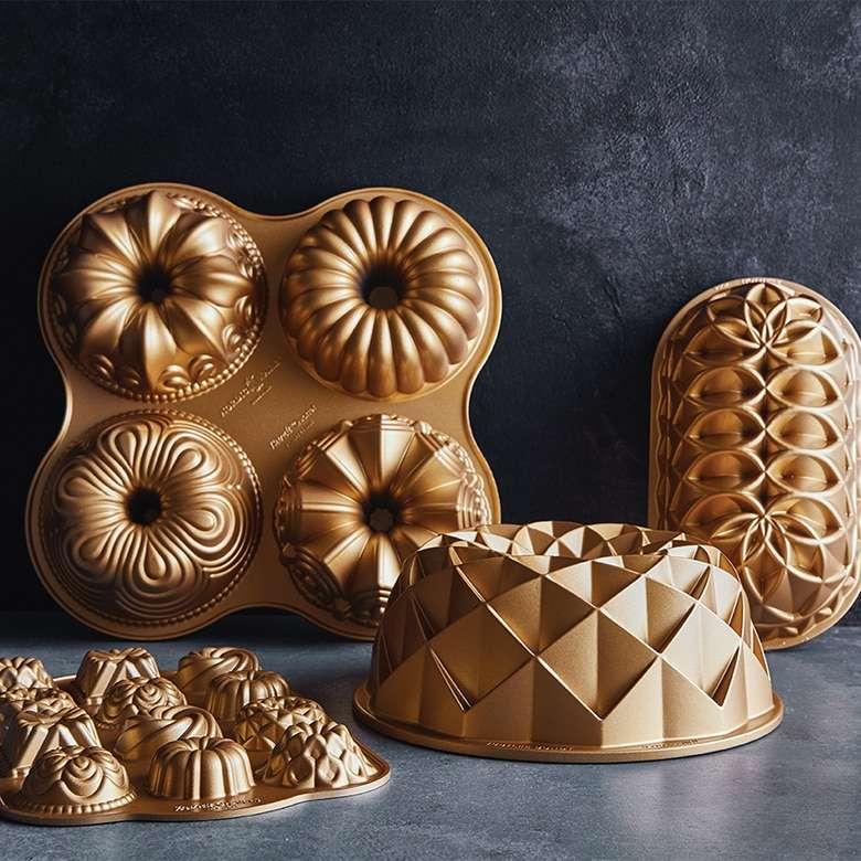 Форма для выпечки Nordic Ware Юбилейный пирог овальная 1,4л, литой алюминий (золотая) NRD82677